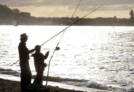 father and son fishing Getty News Images Sandra Mu