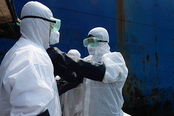 Ebola workers (Photo by ChinaFotoPress/ChinaFotoPress via Getty Images)